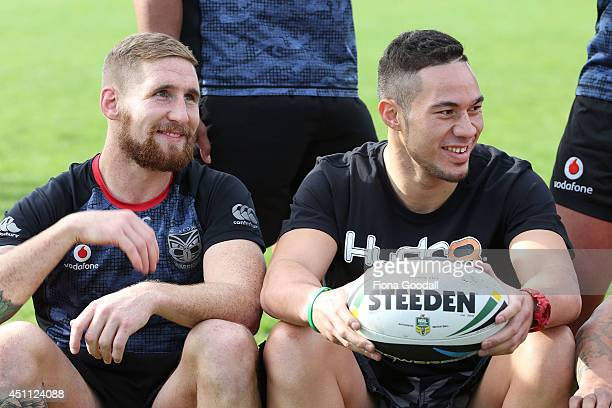 Heavyweight boxer Joseph Parker with Warrior Sam Tomkins as he attends a New Zealand Warriors NRL training session at Mt Smart Stadium on June 24...
