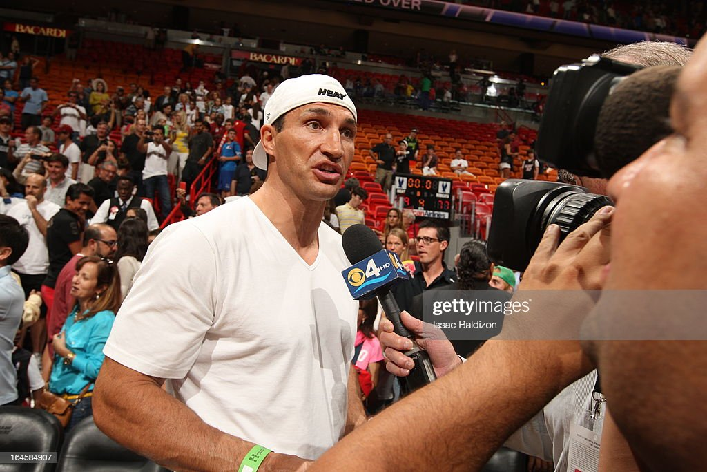 Heavyweight boxer Wladimir Klitschko is interviewed as he attends a game between the Charlotte Bobcats and the Miami Heat on March 24, 2013 at American Airlines Arena in Miami, Florida.