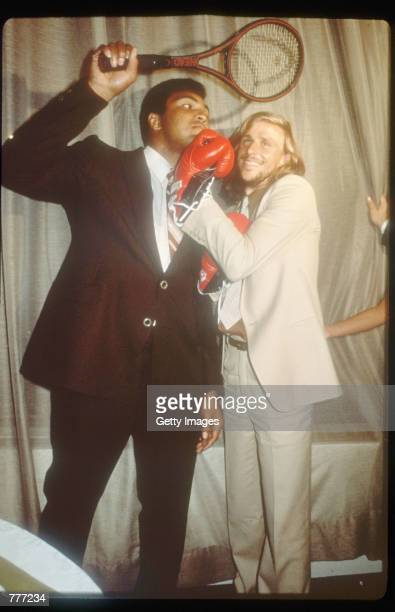 Heavyweight Boxing champion holds a tennis racket over Tennis player Bjorn Borg July 1979 in USA Ali is one of the greatest boxers in the history of...