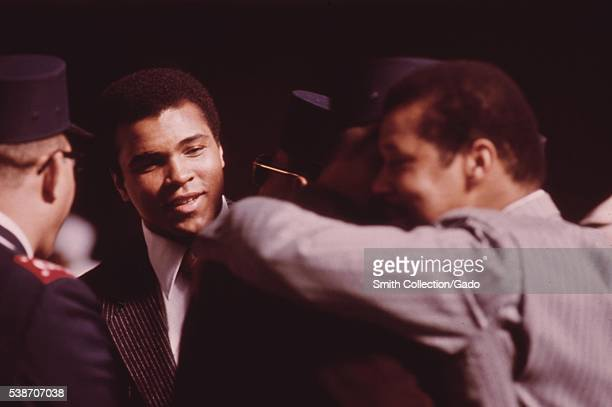 Heavyweight boxing champion Muhammad Ali attends a Savior's Day celebration in Chicago given by Black Muslim religious leader Elijah Muhammad Image...