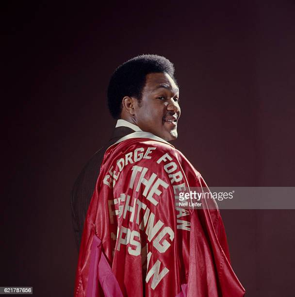 Portrait of WBC champion George Foreman wearing robe over suit during photo shoot Haywood CA CREDIT Neil Leifer