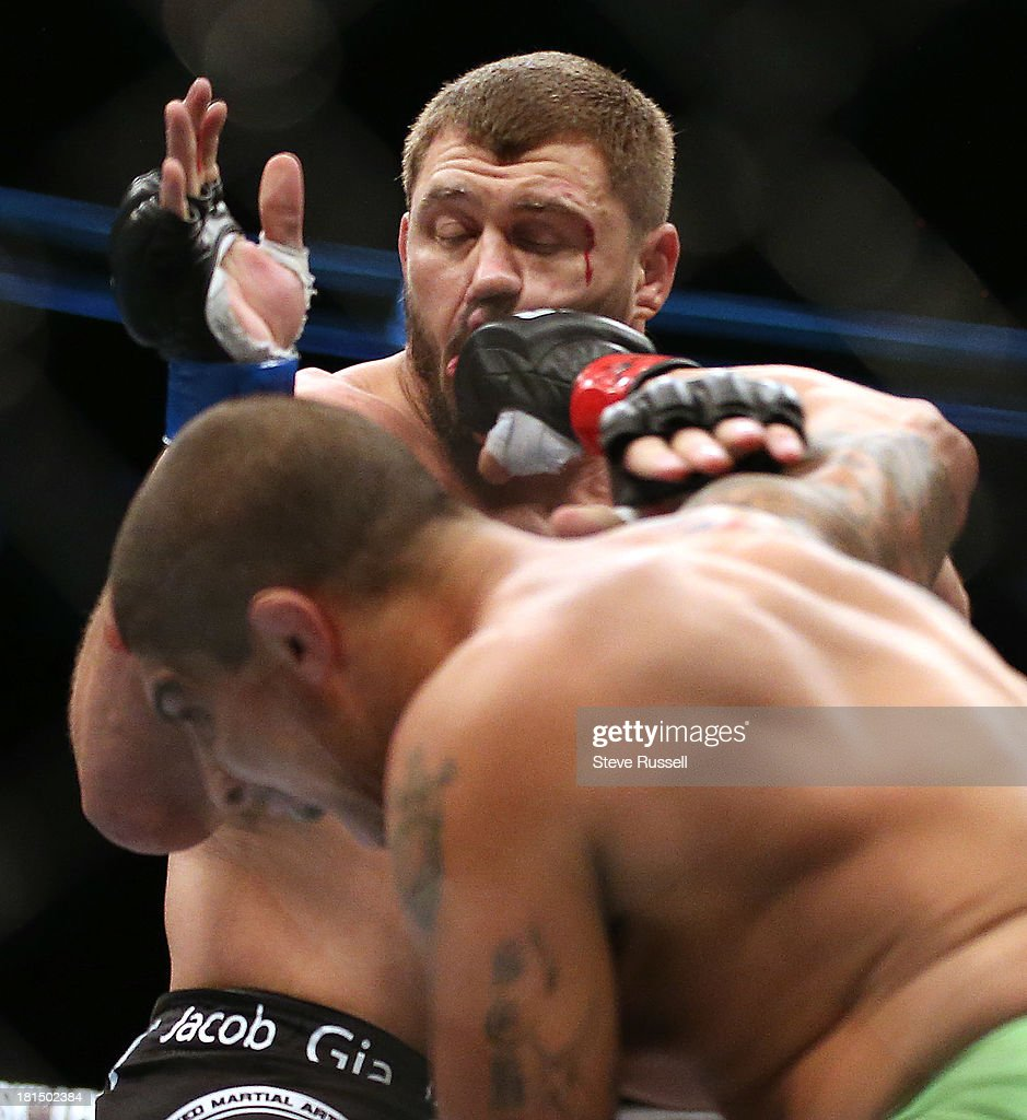 TORONTO, ON- SEPTEMBER 21 - Heavyweight Brendan Schaub from Venice Beach lays a punch and later wins by submission over Matt Mitrione from Boca Raton at UFC 165 at the Air Canada Centre in Toronto, September 21, 2013.