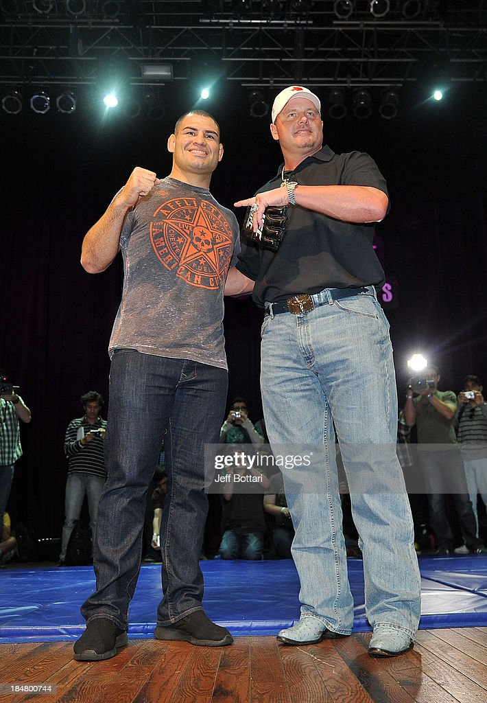 UFC Heavyweight Champion Cain Velasquez and former MLB Houston Astros player Roger Clemens pose for fans and media inside House of Blues on October 16, 2013 in Houston, Texas.