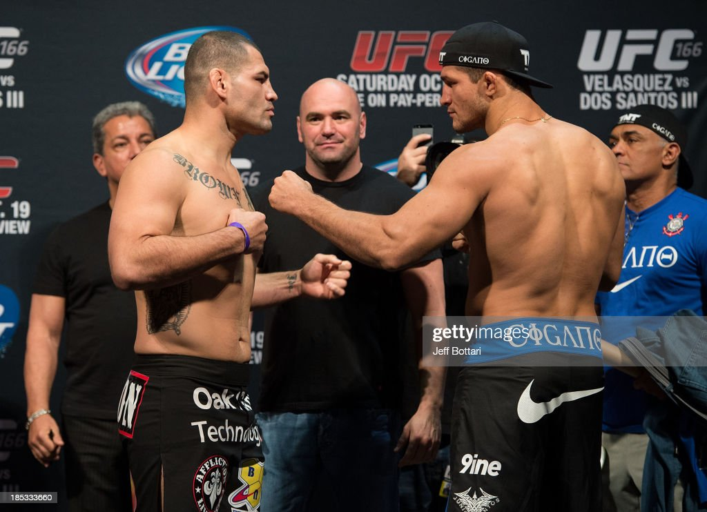 UFC heavyweight champion Cain Velasquez and Junior Dos Santos face off during the UFC 166 weigh-in at the Toyota Center on October 18, 2013 in Houston, Texas.