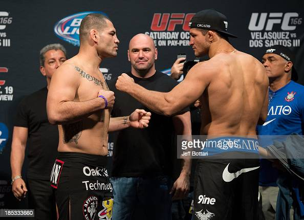 UFC heavyweight champion Cain Velasquez and Junior Dos Santos face off during the UFC 166 weighin at the Toyota Center on October 18 2013 in Houston...