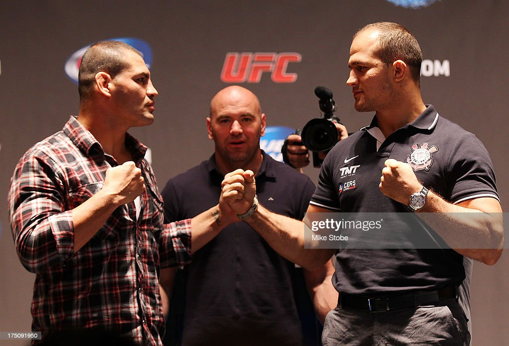 UFC heavyweight champion <a gi-track='captionPersonalityLinkClicked' href=/galleries/search?phrase=Cain+Velasquez&family=editorial&specificpeople=5445619 ng-click='$event.stopPropagation()'>Cain Velasquez</a> and <a gi-track='captionPersonalityLinkClicked' href=/galleries/search?phrase=Junior+Dos+Santos&family=editorial&specificpeople=6312675 ng-click='$event.stopPropagation()'>Junior Dos Santos</a> face-off during a press conference at Beacon Theatre on July 31, 2013 in New York City.