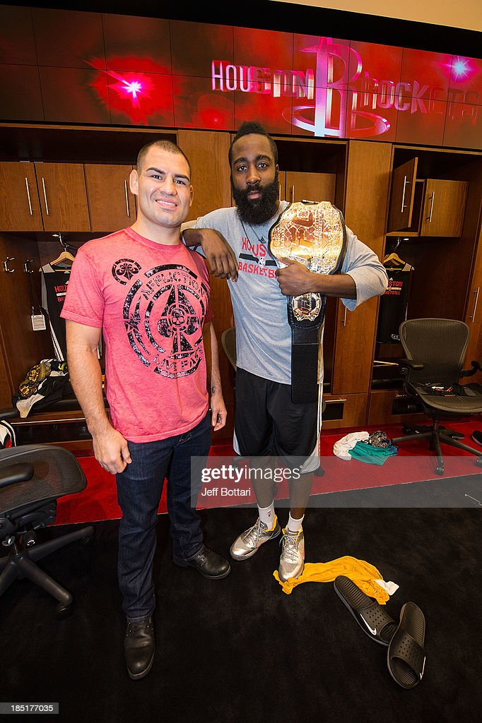 UFC Heavyweight Champion <a gi-track='captionPersonalityLinkClicked' href=/galleries/search?phrase=Cain+Velasquez&family=editorial&specificpeople=5445619 ng-click='$event.stopPropagation()'>Cain Velasquez</a> and NBA Houston Rockets player <a gi-track='captionPersonalityLinkClicked' href=/galleries/search?phrase=James+Harden&family=editorial&specificpeople=4215938 ng-click='$event.stopPropagation()'>James Harden</a> pose in the Houston Rockets locker room during the UFC 166 Ultimate Media Day at the Toyota Center on October 16, 2013 in Houston, Texas.