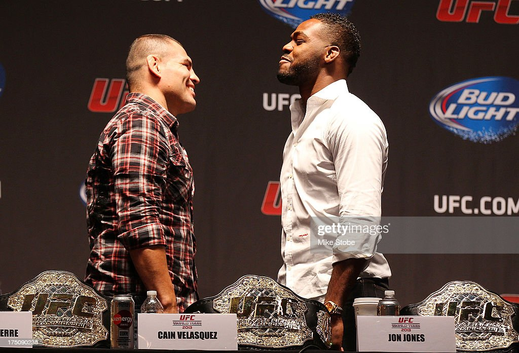 UFC heavyweight champion <a gi-track='captionPersonalityLinkClicked' href=/galleries/search?phrase=Cain+Velasquez&family=editorial&specificpeople=5445619 ng-click='$event.stopPropagation()'>Cain Velasquez</a> and UFC light heavyweight champion <a gi-track='captionPersonalityLinkClicked' href=/galleries/search?phrase=Jon+Jones+-+Mixed+Martial+Artist&family=editorial&specificpeople=8928306 ng-click='$event.stopPropagation()'>Jon Jones</a> face-off during a press conference at Beacon Theatre on July 31, 2013 in New York City.