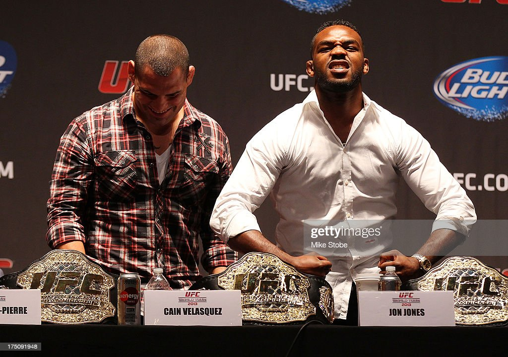 UFC heavyweight champion <a gi-track='captionPersonalityLinkClicked' href=/galleries/search?phrase=Cain+Velasquez&family=editorial&specificpeople=5445619 ng-click='$event.stopPropagation()'>Cain Velasquez</a> and UFC light heavyweight champion <a gi-track='captionPersonalityLinkClicked' href=/galleries/search?phrase=Jon+Jones+-+Mixed+Martial+Artist&family=editorial&specificpeople=8928306 ng-click='$event.stopPropagation()'>Jon Jones</a> interact during a press conference at Beacon Theatre on July 31, 2013 in New York City.