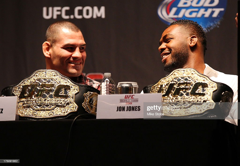 UFC heavyweight champion Cain Velasquez and UFC light heavyweight champion Jon Jones share a laugh during a press conference at Beacon Theatre on July 31, 2013 in New York City.