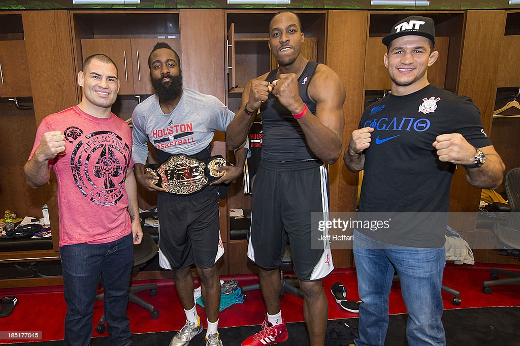 UFC Heavyweight Champion <a gi-track='captionPersonalityLinkClicked' href=/galleries/search?phrase=Cain+Velasquez&family=editorial&specificpeople=5445619 ng-click='$event.stopPropagation()'>Cain Velasquez</a>, NBA Houston Rockets players <a gi-track='captionPersonalityLinkClicked' href=/galleries/search?phrase=James+Harden&family=editorial&specificpeople=4215938 ng-click='$event.stopPropagation()'>James Harden</a>, <a gi-track='captionPersonalityLinkClicked' href=/galleries/search?phrase=Dwight+Howard&family=editorial&specificpeople=201570 ng-click='$event.stopPropagation()'>Dwight Howard</a> and UFC fighter <a gi-track='captionPersonalityLinkClicked' href=/galleries/search?phrase=Junior+Dos+Santos&family=editorial&specificpeople=6312675 ng-click='$event.stopPropagation()'>Junior Dos Santos</a> pose in the Houston Rockets locker room during the UFC 166 Ultimate Media Day at the Toyota Center on October 16, 2013 in Houston, Texas.