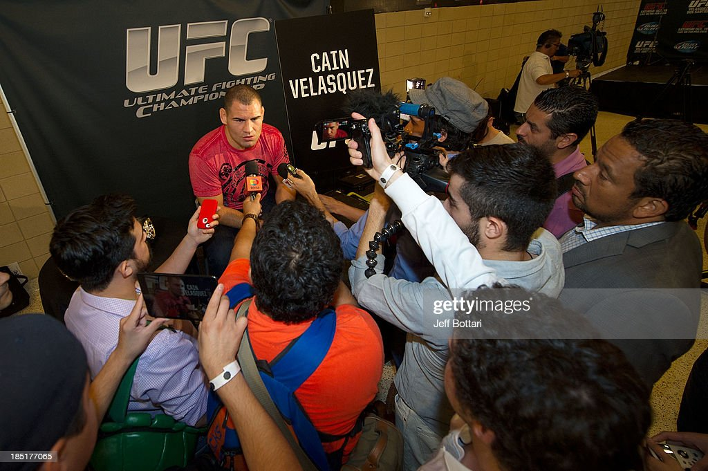 UFC heavyweight champion <a gi-track='captionPersonalityLinkClicked' href=/galleries/search?phrase=Cain+Velasquez&family=editorial&specificpeople=5445619 ng-click='$event.stopPropagation()'>Cain Velasquez</a> speaks with the media during the UFC 166 Ultimate Media Day at the Toyota Center on October 16, 2013 in Houston, Texas.