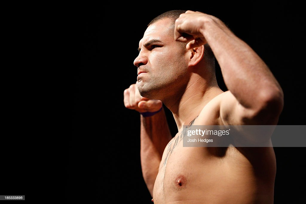 Heavyweight Champion <a gi-track='captionPersonalityLinkClicked' href=/galleries/search?phrase=Cain+Velasquez&family=editorial&specificpeople=5445619 ng-click='$event.stopPropagation()'>Cain Velasquez</a> weighs in during the UFC 166 weigh-in event at the Toyota Center on October 18, 2013 in Houston, Texas.