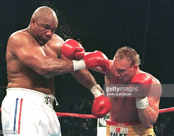 IBF heavyweight champion George Foreman of the US takes a right from challenger Axel Schulz of Germany in the fourth round of their title bout in Las...