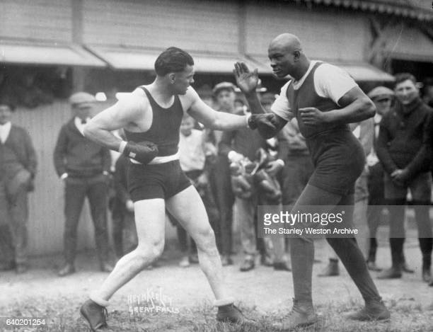 Heavyweight Champion Jack Dempsey about to go to work on his favorite sparring partner George Godfrey while training for his Independence Day title...