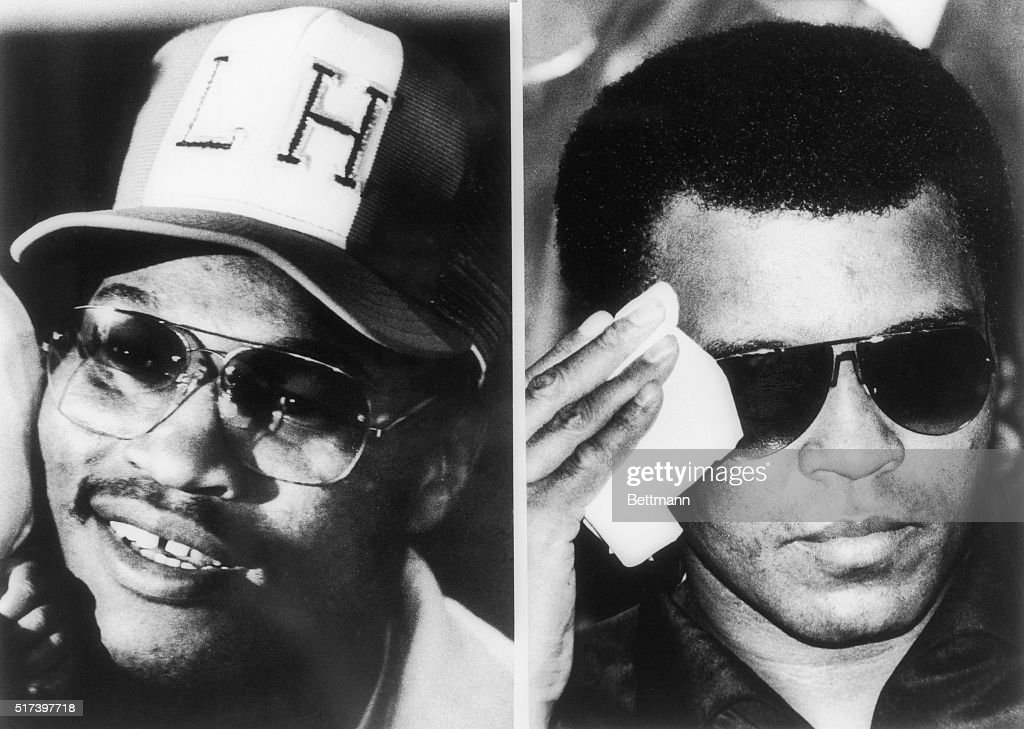WBC Heavyweight champion Larry Holmes (L) is all smiles at a joint news conference with defeated champ Muhammad Ali (R). Ali appeared at the press conference wearing dark sunglasses and a swollen face. Holmes won the championship fight by a TKO in the 10th round.