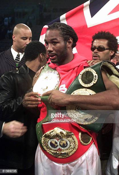IBF heavyweight champion Lennox Lewis from England holds his belts after defeating Samoanborn David Tua from New Zealand at Mandalay Bay Casino in...