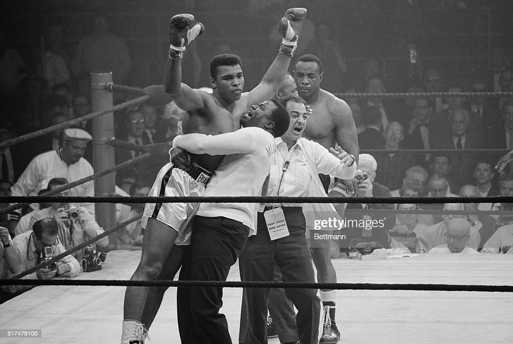 Heavyweight champion Muhammad Ali is lifted in jubilation after his match with boxer Sonny Liston. Clay knocked out Liston in the first round of the May 25, 1965 match to retain his title.