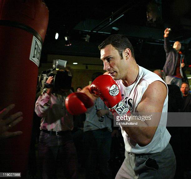 Heavyweight Champion Vitali Klitschko hits the heavy bag during a workout for his upcoming WBC Heavyweight Championship defense against Danny...