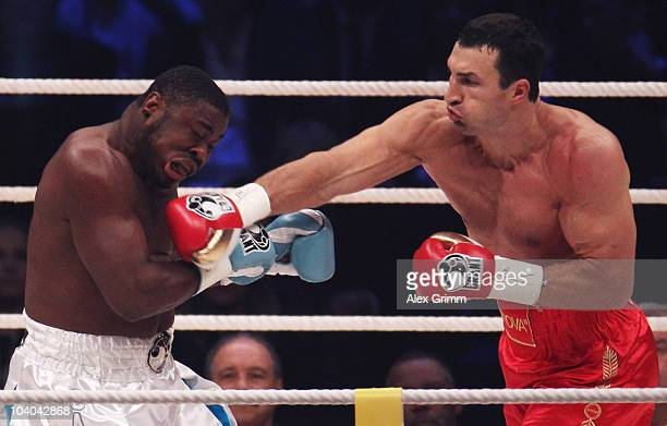 Heavyweight champion Wladimir Klitschko of Ukraine lands a punch on challenger Samuel Peter of Nigeria during their WBO and IBF World Championship...
