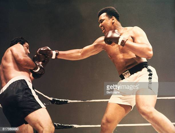 Heavyweight champions Muhammad Ali and Rocky Marciano boxing in composited film created in 1970