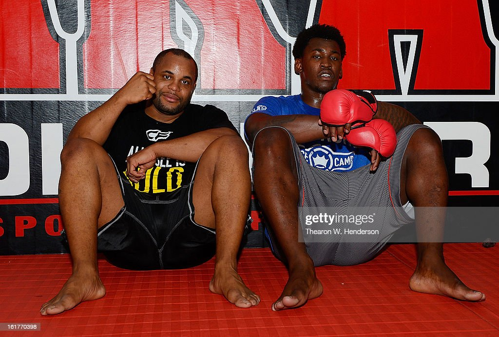 Heavyweight fighter Daniel Comier (L) and San Francisco 49ers defensive end Aldon Smith (R) sits together after working out at AKA San Jose on February 15, 2013 in San Jose, California.