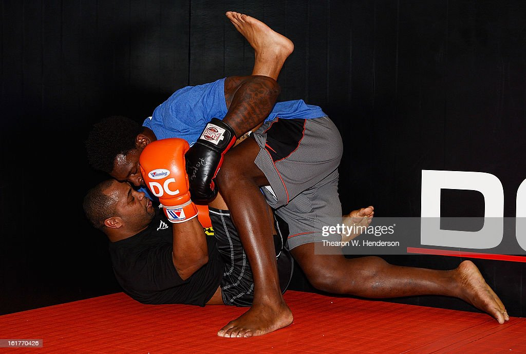 Heavyweight fighter Daniel Comier, bottom, works out with San Francisco 49ers defensive end Aldon Smith, top, at AKA San Jose on February 15, 2013 in San Jose, California.