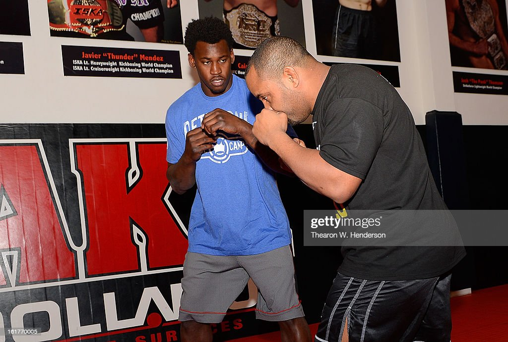 Heavyweight fighter Daniel Comier (R) works out with San Francisco 49ers defensive end Aldon Smith at AKA San Jose on February 15, 2013 in San Jose, California.