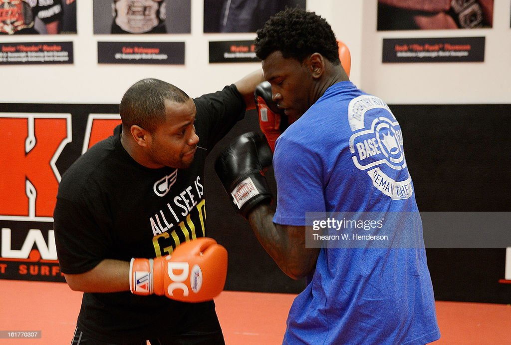 Heavyweight fighter Daniel Comier (L) works out with San Francisco 49ers defensive end Aldon Smith (R) at AKA San Jose on February 15, 2013 in San Jose, California.