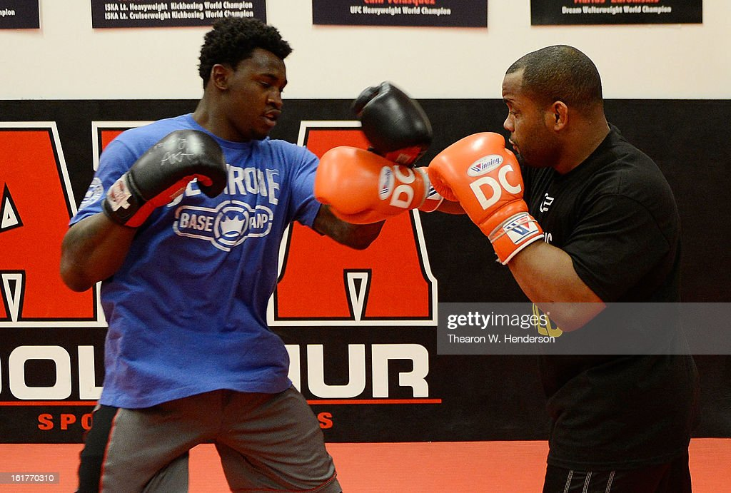 Heavyweight fighter Daniel Comier (R) works out with San Francisco 49ers defensive end Aldon Smith (L) at AKA San Jose on February 15, 2013 in San Jose, California.