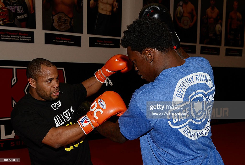 Heavyweight fighter Daniel Comier (L) works out with San Francisco 49ers defensive end <a gi-track='captionPersonalityLinkClicked' href=/galleries/search?phrase=Aldon+Smith&family=editorial&specificpeople=6522981 ng-click='$event.stopPropagation()'>Aldon Smith</a> (R) at AKA San Jose on February 15, 2013 in San Jose, California.
