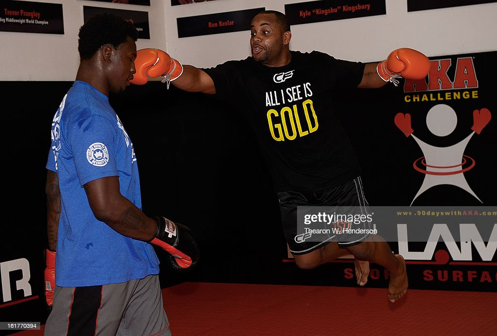 Heavyweight fighter Daniel Comier (R) works out with San Francisco 49ers defensive end <a gi-track='captionPersonalityLinkClicked' href=/galleries/search?phrase=Aldon+Smith&family=editorial&specificpeople=6522981 ng-click='$event.stopPropagation()'>Aldon Smith</a> (L) at AKA San Jose on February 15, 2013 in San Jose, California.