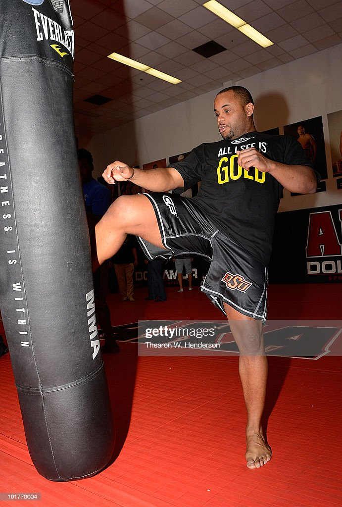 Heavyweight fighter Daniel Cormier demonstrates kicking while working out with San Francisco 49ers defensive end Aldon Smith at AKA San Jose on February 15, 2013 in San Jose, California.