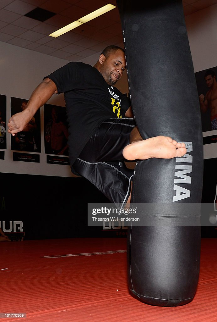 Heavyweight fighter <a gi-track='captionPersonalityLinkClicked' href=/galleries/search?phrase=Daniel+Cormier&family=editorial&specificpeople=171300 ng-click='$event.stopPropagation()'>Daniel Cormier</a> demonstrates kicking while working out with San Francisco 49ers defensive end Aldon Smith at AKA San Jose on February 15, 2013 in San Jose, California.