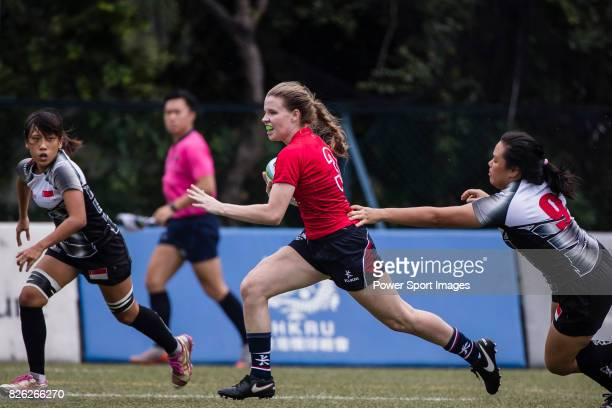 Hebe Talas of Hong Kong is tackled by Demi Wong Qian Qian of Singapore during the Asia Rugby U20 Sevens 2017 at King's Park Sports Ground on August 4...