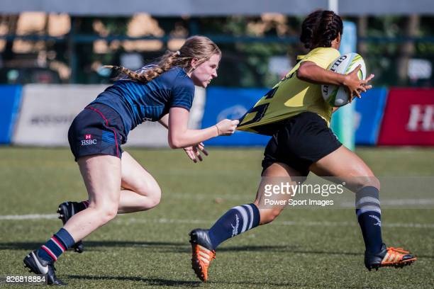 Hebe Talas of Hong Kong tackles Phatchareeporn Jaiping of Thailand during the Asia Rugby U20 Sevens 2017 at King's Park Sports Ground on August 5...