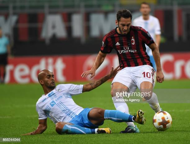 Heber of Hrvatski Nogometni Klub Rijeka in action against Hakan Calhanoglu of AC Milan during the UEFA Europa League Group stage match between AC...