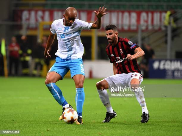 Heber of Hrvatski Nogometni Klub Rijeka in action against Mateo Musacchio of AC Milan during the UEFA Europa League Group stage match between AC...