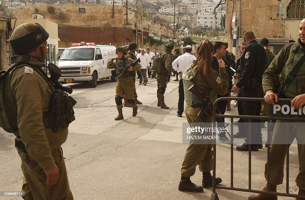 Seen israeli inspector and soldiers in the area where a palestinian girl was been shots to death by an israeli soldier as she try to stabbed (as israeli news sources) in the old city of the West Bank town of Hebron.February 13,2016.AFP PHOTO/HAZEM BADER / AFP / HAZEM BADER