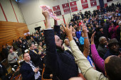 Hecklers over immigration policy interrupt US President Barack Obama as he speaks in support of of Connecticut Governor Dan Malloy on November 2 2014...