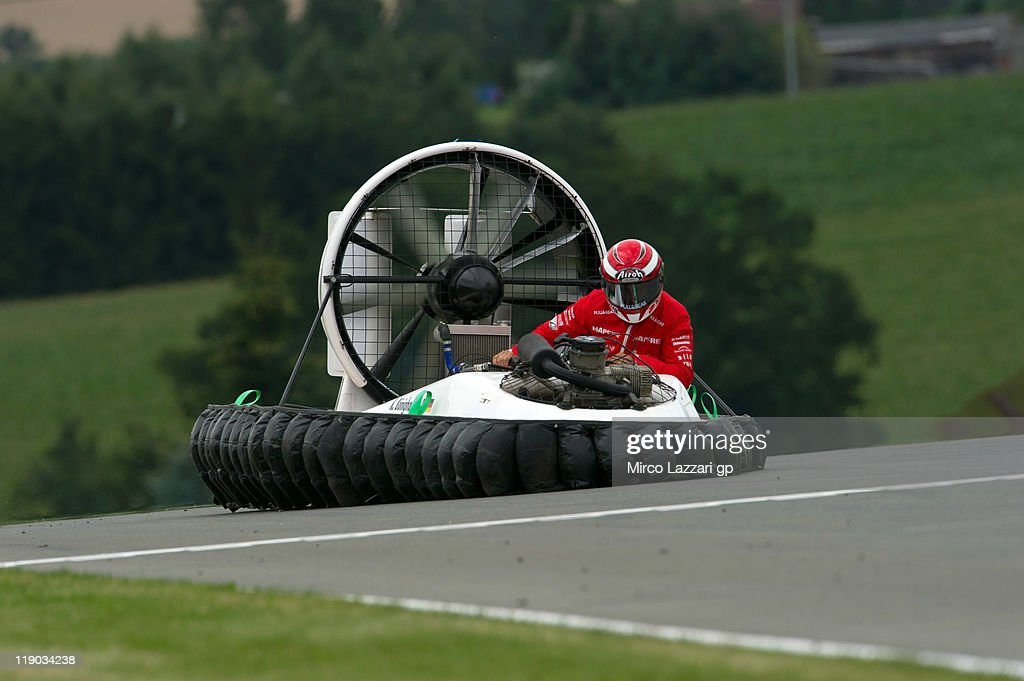 JULY 14 Hector Barbera of Spain and Aspar Ducati Team drives the hovercraft on track during the preevent 'Riders from the 3 categories will drive...