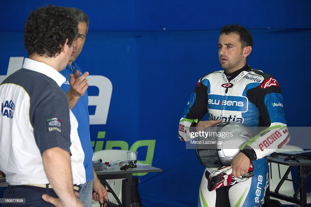 <a gi-track='captionPersonalityLinkClicked' href=/galleries/search?phrase=Hector+Barbera&family=editorial&specificpeople=626957 ng-click='$event.stopPropagation()'>Hector Barbera</a> of Spain and Avintia Racing MotoGP speaks with mechanics during day one of CRT Tests for the MotoGP at Sepang Circuit on February 3, 2013 in Kuala Lumpur, Malaysia.