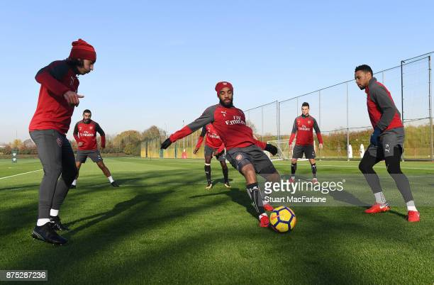 Hector Bellerin Alex Lacazette and Francis Coquelin of Arsenal during a training session at London Colney on November 17 2017 in St Albans England