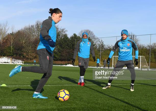 Hector Bellerin Alex Lacazette and Mathieu Debuchy of Arsenal during a training session at London Colney on December 12 2017 in St Albans England