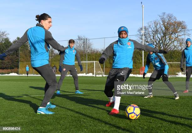 Hector Bellerin and Alex Lacazette of Arsenal during a training session at London Colney on December 12 2017 in St Albans England