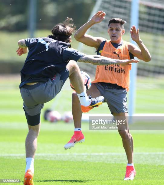Hector Bellerin and Alexis Sanchez of Arsenal during a training session at London Colney on May 26 2017 in St Albans England