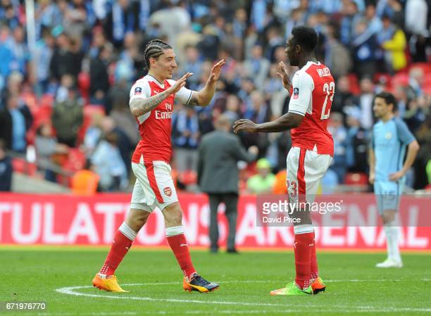Hector Bellerin and Danny Welbeck of Arsenal celebrate after the match between Arsenal and Manchester City at Wembley Stadium on April 23 2017 in...