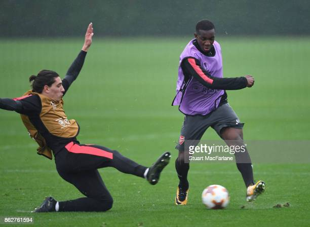 Hector Bellerin and Eddie Nketiah of Arsenal during a training session at London Colney on October 18 2017 in St Albans England