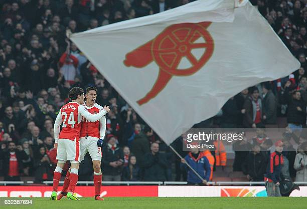 Hector Bellerin and Gabriel of Arsenal celebrate after the match during the Premier League match between Arsenal and Burnley at Emirates Stadium on...