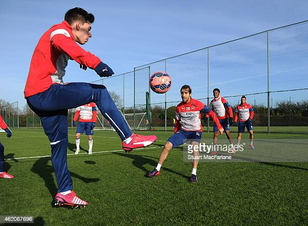 Hector Bellerin and Mathieu Flamini of Arsenal during a training session at London Colney on January 24 2015 in St Albans England